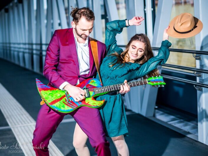 Couple with a colorful guitar