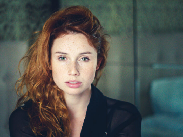 Red-haired girl in the apartment